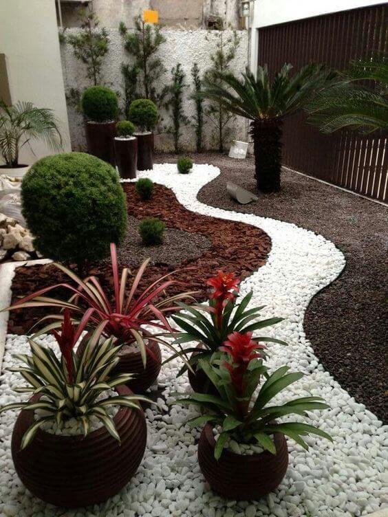 jardim de inverno com pedras brancas