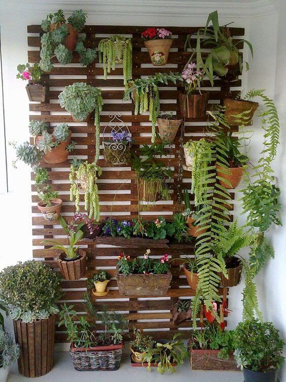 jardim de inverno com parede suspensa e jardim vertical